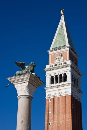 campanile with the lion statue pazzia san marco saint mark square in the beautiful city of venice in italy photo