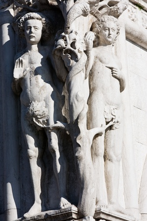 adam and eve statue on the dodge palace pazzia san marco saint mark place in the beautiful city of venice in italy photo