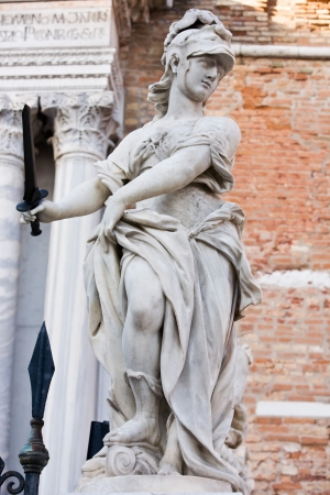 pallas: statue of helmeted pallas athena minerva in the beautiful city of venice in italy