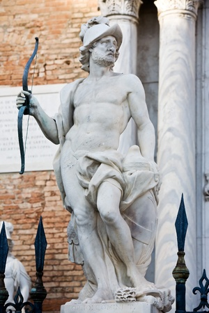 statue of mars ares in the beautiful city of venice in italy photo
