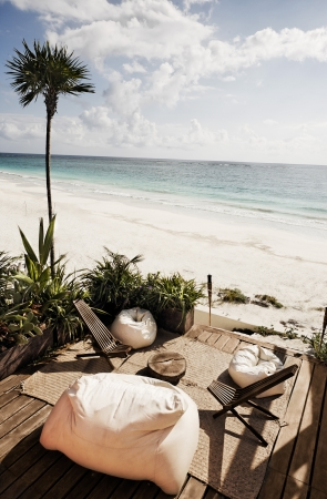with bean bag chair a view of the beautiful white sand beach of tulum in yucatan mexico photo
