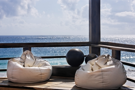 balcony design: with bean bag chair a view of the beautiful white sand beach of tulum in yucatan mexico