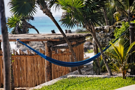 cabana: terrace of a cabana with a hamac and a view of the beautiful white sand beach of tulum in yucatan mexico