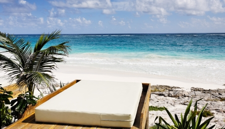 cabana: terrace of a cabana with a view of the beautiful white sand beach of tulum in yucatan mexico Stock Photo