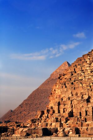 nile: view of the pyramids of gizah near cairo in egypt