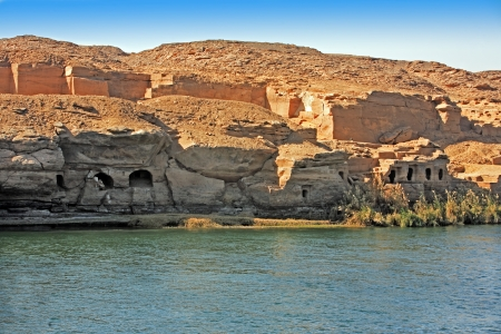 troglodytes: Cliff Dwelling troglodytes house on the shore of the river nile in egypt Stock Photo