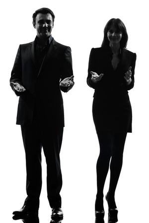 one caucasian couple business woman man in silhouette studio isolated on white background photo