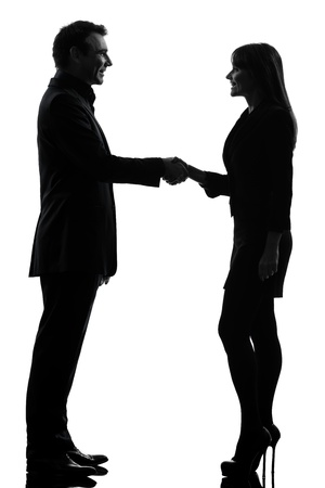 one caucasian couple business woman man handshake in silhouette studio isolated on white background