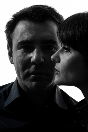 one caucasian couple woman man close up portrait  in silhouette studio isolated on white background Stock Photo