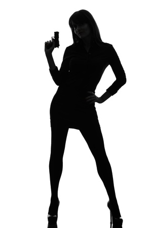 one caucasian sexy detective  woman holding aiming  gun in silhouette studio isolated on white background Stock Photo - 17311038