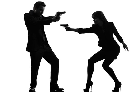 one caucasian man detective secret agent criminal  with gun  in silhouette studio isolated on white background Stock Photo