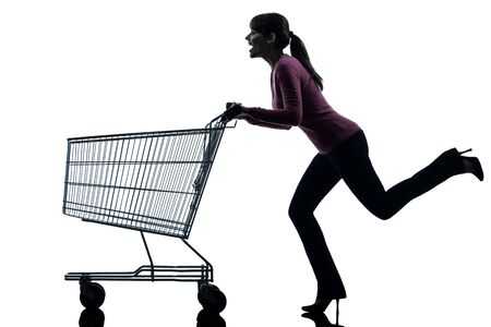 one caucasian woman with empty shopping cart in silhouette studio isolated on white background photo