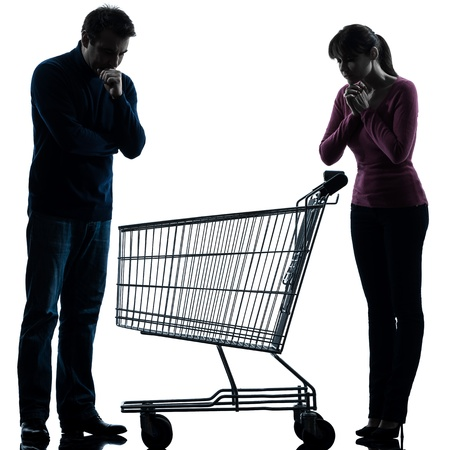 one caucasian couple woman man sad with empty shopping with shopping cart  in silhouette studio isolated on white background Stock Photo - 17342712