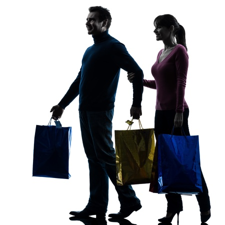 one caucasian couple woman man christmas present shopping  in silhouette studio isolated on white background Stock Photo - 17316402
