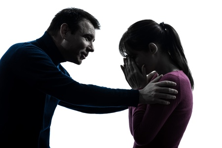 affection: one caucasian couple woman crying man consoling  in silhouette studio isolated on white background