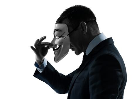 PARIS-30 de octubre: un hombre vestido y enmascarado como un miembro del grupo clandestino Anonymous el 30 de octubre de 2012 en París, Francia Editorial