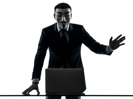 protestor: PARIS– OCTOBER 30 : one man dressed and masked as a  member of Anonymous underground group member computing computer  saluting on October 30, 2012 in Paris ,France