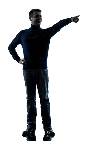 one caucasian man pointing finger  full length in silhouette studio isolated on white background Stock Photo - 17310245
