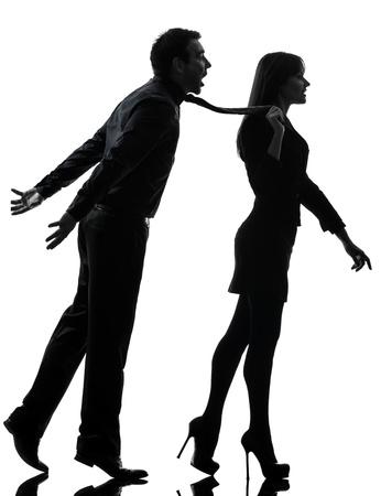 dominacion: una pareja cauc�sica mujer seductora concepto de uni�n en el estudio de la silueta aislado en el fondo blanco Foto de archivo