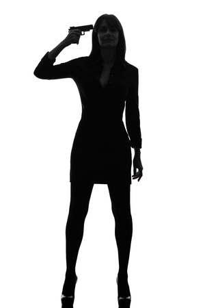 one caucasian sexy detective  woman holding aiming  gun in silhouette studio isolated on white background Stock Photo - 17316356
