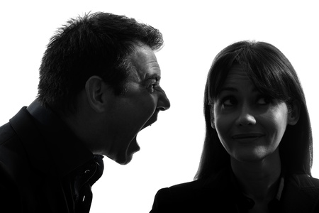 one caucasian couple man screaming  woman  in silhouette studio isolated on white background photo