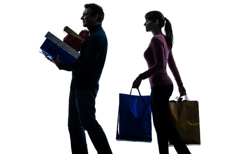 one caucasian couple woman man christmas present shopping  in silhouette studio isolated on white background photo