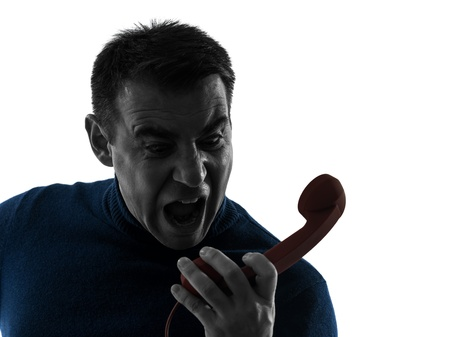 one caucasian angry man on the phone portrait in silhouette studio isolated on white background photo