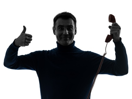 one caucasian man on the phone thumb up  portrait in silhouette studio isolated on white background Stock Photo - 17310256