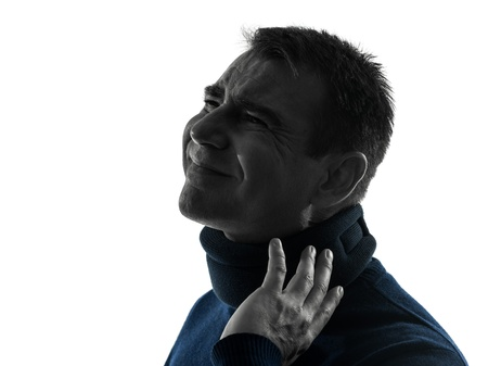 one caucasian man with cervical collar neck ache  portrait in silhouette studio isolated on white background Stock Photo - 17310310