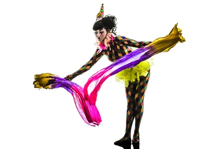 one caucasian woman harlequin circus dancer performer  in silhouette studio isolated on white background photo