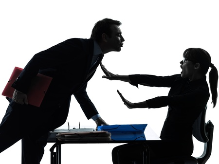 abuse: one caucasian business woman man couple sexual harassment in silhouette studio isolated on white background Stock Photo