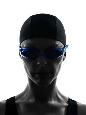 cut the competition: one caucasian woman competion swimmer portrait  in silhouette studio isolated on white background Stock Photo