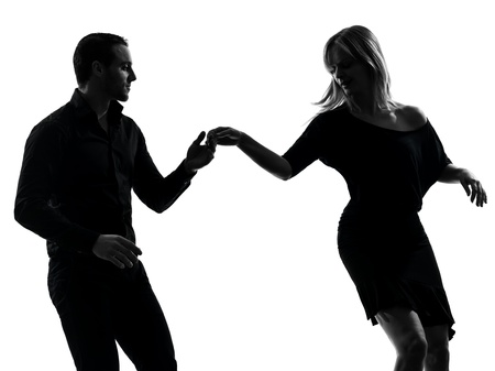 salsa dancing: one caucasian couple woman man dancing dancers salsa rock  in silhouette studio isolated on white background