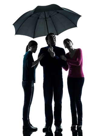 one caucasian family father mother daughter man under umbrella  danger afraid  in silhouette studio isolated on white background photo