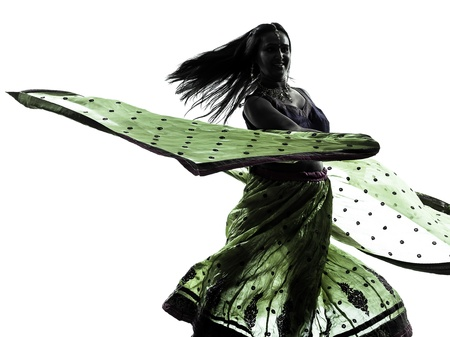 dancing silhouette: one indian woman dancer dancing in silhouette studio isolated on white background Stock Photo
