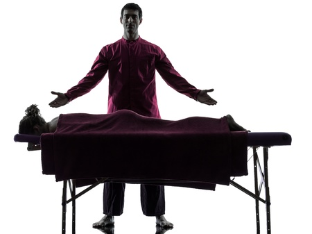 massage table: in silhouette studio on white background Stock Photo