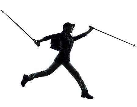 one caucasian woman trekker trekking running  in silhouette studio isolated on white background Stock Photo - 17419778