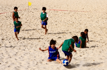 rio de janeiro: brazilian kids palying soccer on ipanema beach in rio de janeiro brazil