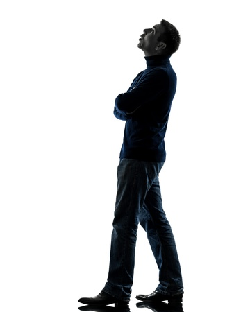 one caucasian man looking up pensive  full length in silhouette studio isolated on white background Stock Photo - 17798204