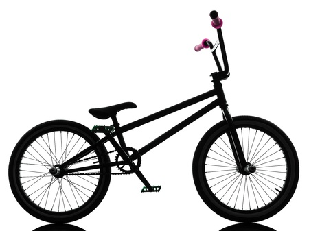 one bmx bicycle  in silhouette studio isolated on white background photo
