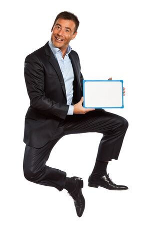 one caucasian business man  jumping holding showing whiteboard in studio isolated on white background photo