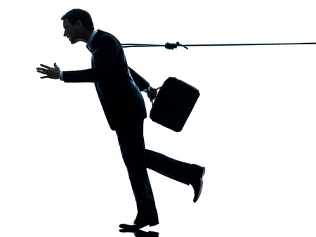 gevangen: een caucasian zaken man gevangen door lasso touw in silhouet studio geà ¯ soleerd op witte achtergrond