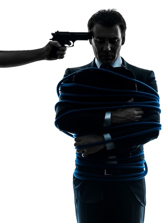 gangster background: captive hostage business man  in silhouette studio isolated on white background Stock Photo