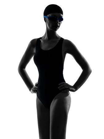 cut the competition: one caucasian woman competition swimmer portrait  in silhouette studio isolated on white background Stock Photo