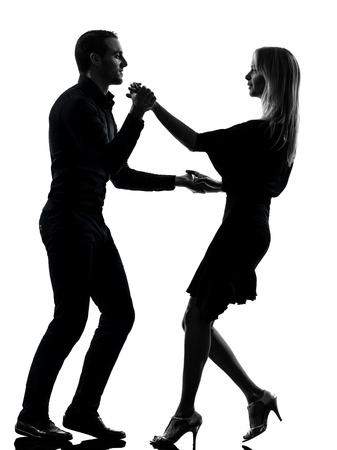 danseres silhouet: een Kaukasische paar vrouw man dansen dansers salsa rots in silhouet studio geà ¯ soleerd op witte achtergrond