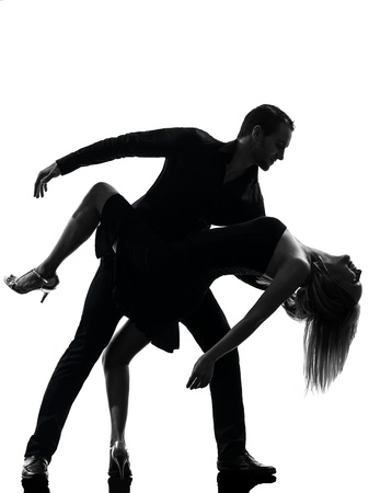 salsa dance: one caucasian couple woman man dancing dancers salsa rock  in silhouette studio isolated on white background