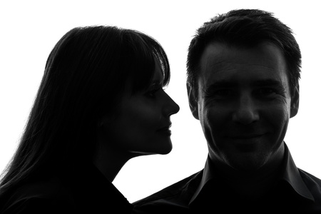 profile face: one caucasian couple woman man close up portrait  in silhouette studio isolated on white background Stock Photo