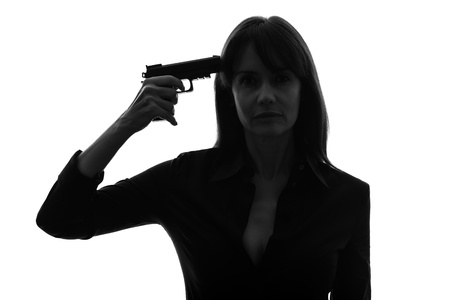 one caucasian sexy detective  woman holding aiming  gun in silhouette studio isolated on white background photo