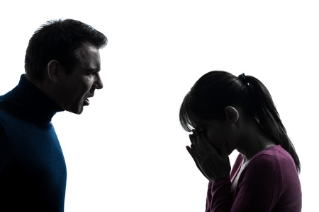 adult crying: one caucasian couple woman man dispute    in silhouette studio isolated on white background