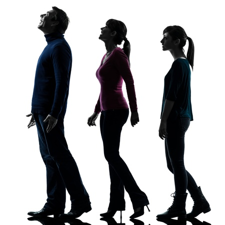 Amazed: one caucasian family father mother daughter man looking up surprised happy in silhouette studio isolated on white background Stock Photo